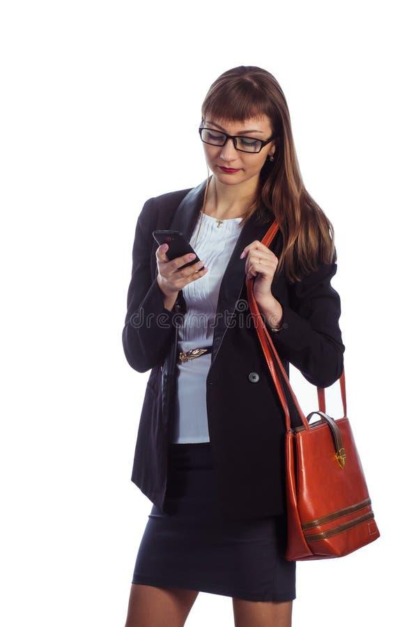 有移动电话的女商人 免版税图库摄影