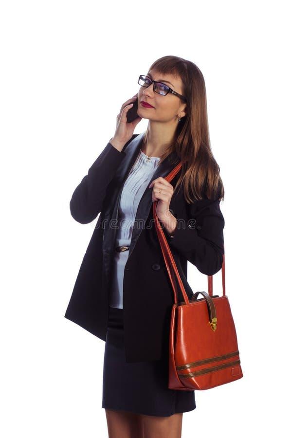 有移动电话的女商人 免版税库存图片