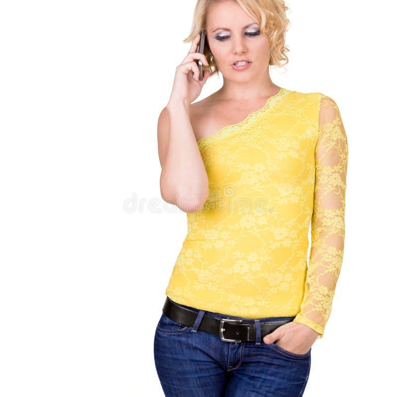 有移动电话的女孩 免版税库存照片