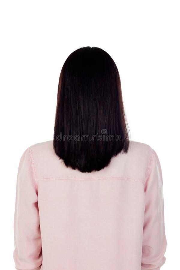 有黑发的一根美丽的鬃毛的妇女后面 免版税图库摄影