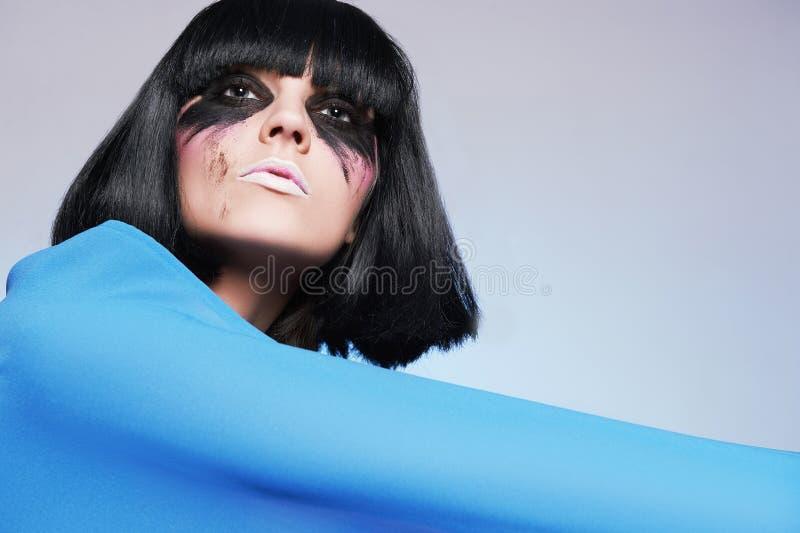 有黑发的肮脏的化妆师 免版税库存图片