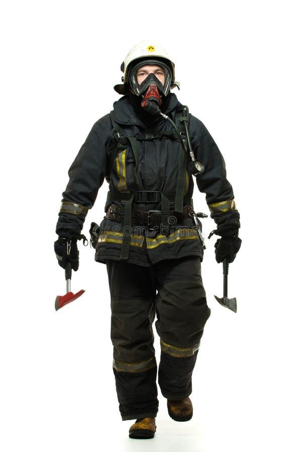 有轴和氧气面罩的消防队员 免版税库存图片