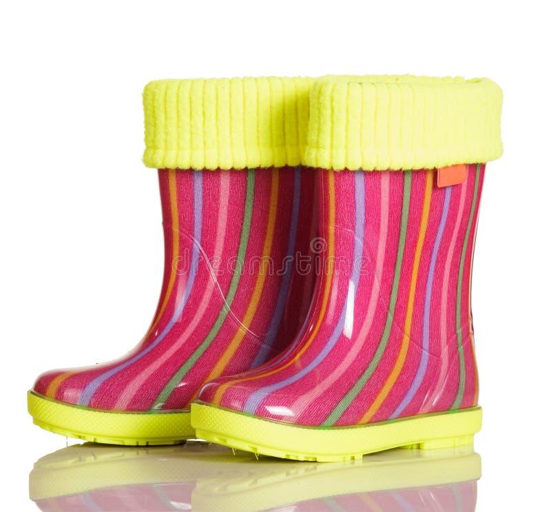 有织品插页的儿童胶靴被隔绝的走的 免版税库存照片