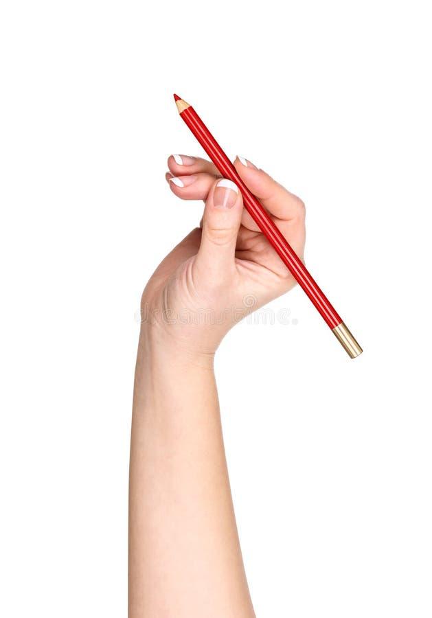 有嘴唇的铅笔等高的手 免版税库存照片