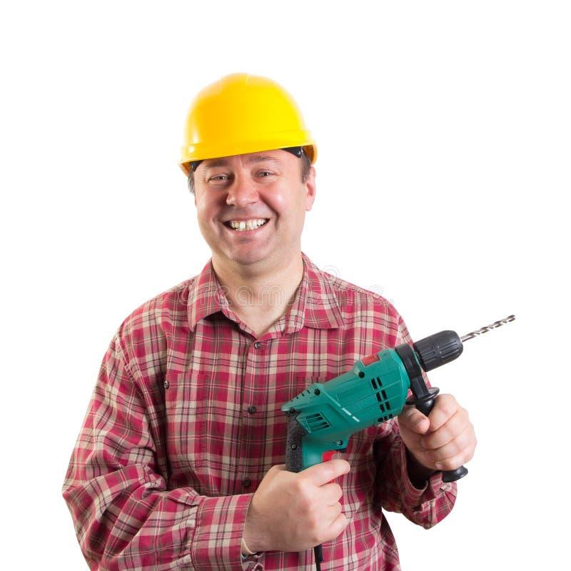 有钻子的微笑的工作员 库存照片