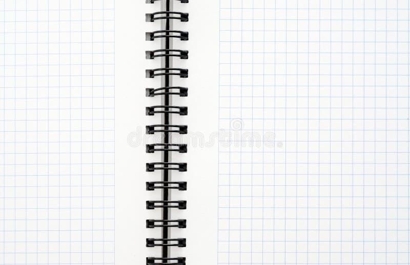 有黑导线的笔记本 库存照片