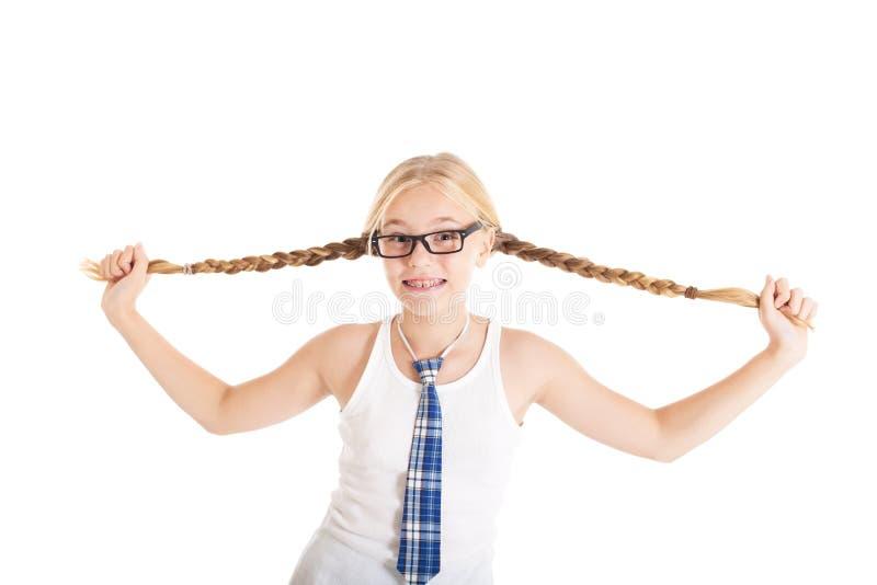 女小学生舒展在旁边他们长的辫子。 图库摄影