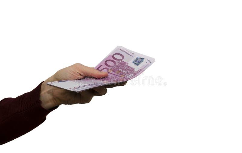 有500欧元票据的手在白色背景 免版税库存图片