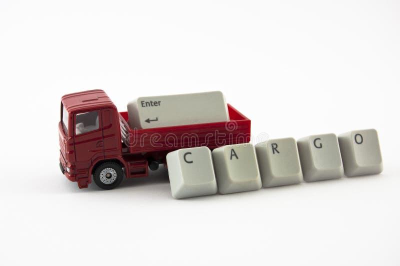 有货物的卡车玩具从键盘键 免版税库存图片