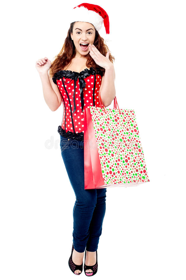 有购物袋的惊奇的夫人 免版税库存照片