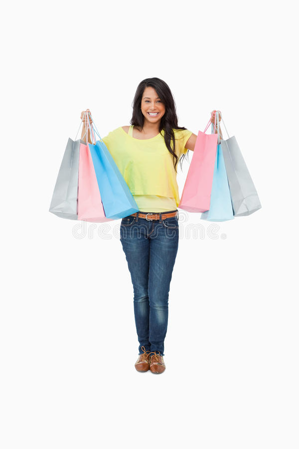 有购物袋的放光的女学生 库存照片