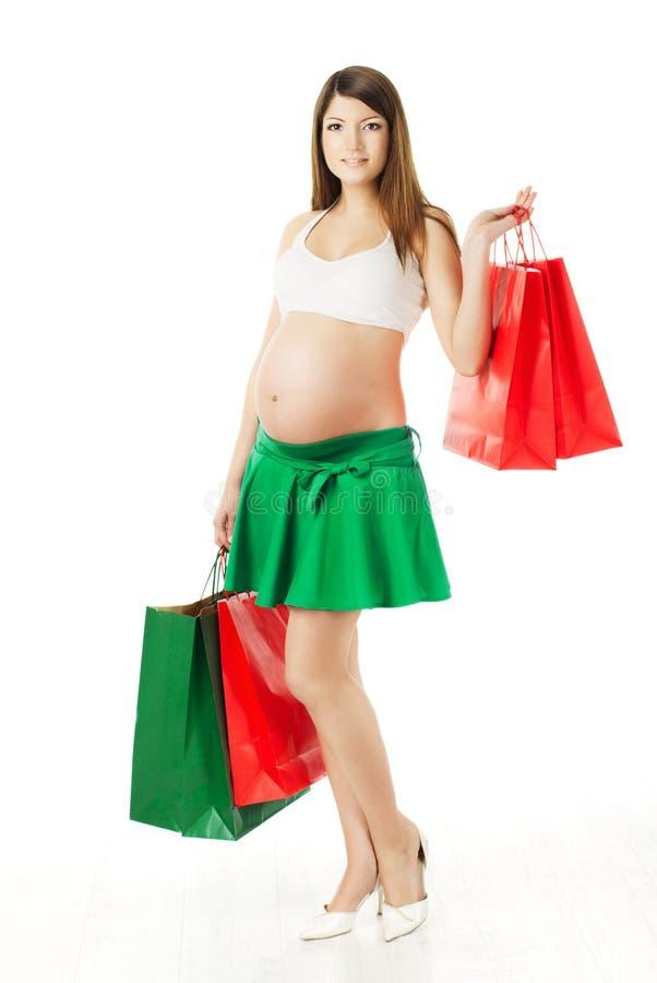 有购物袋的美丽的孕妇 库存照片