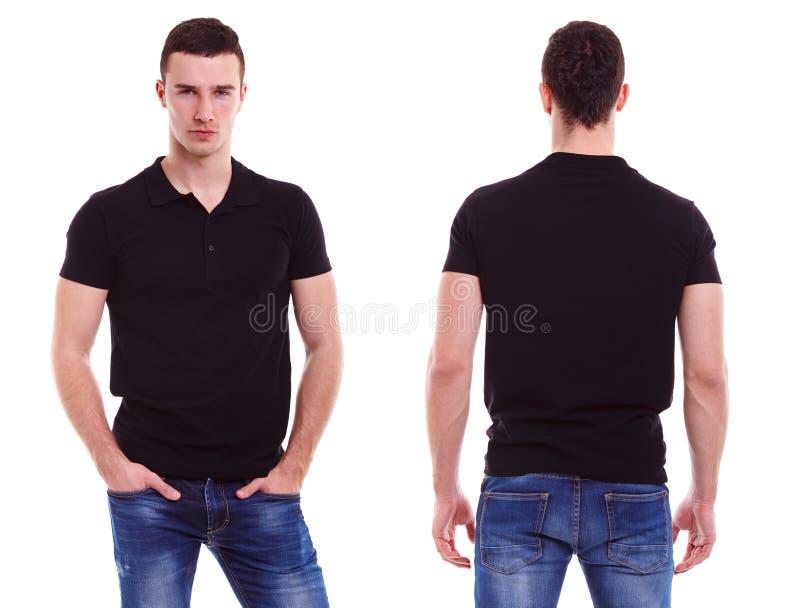 有黑球衣的年轻人 库存照片