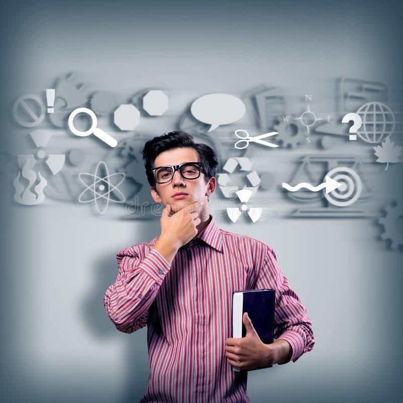 有玻璃认为的年轻人科学家 免版税库存图片