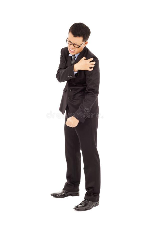 有年轻的商人肩膀痛苦 库存图片