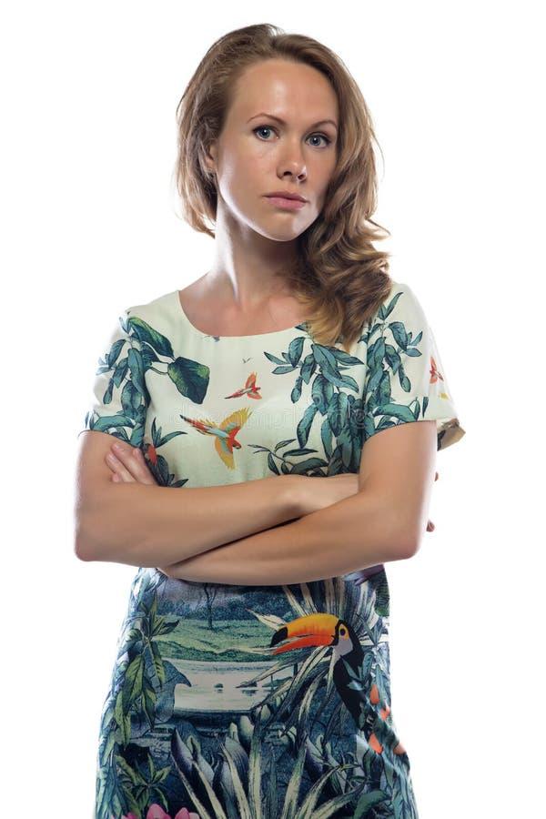 有轻的头发的,横渡的胳膊照片妇女 免版税图库摄影
