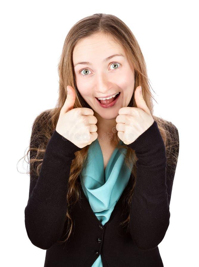 有滑稽的微笑的愉快的少妇给在白色ba的赞许 免版税图库摄影