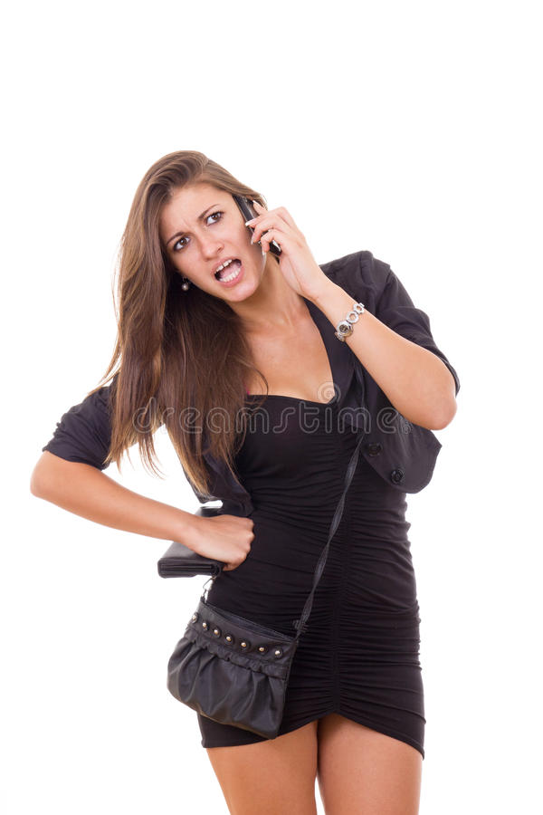有年轻美丽的女商人在电话的讨论 图库摄影
