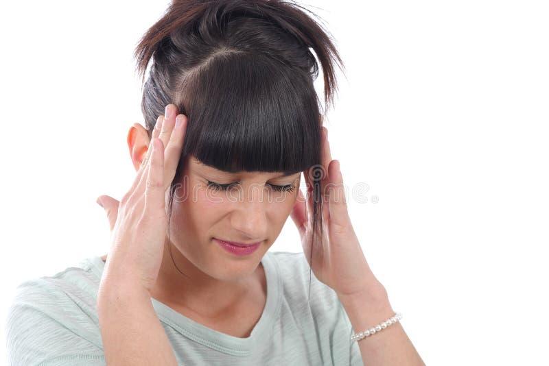 有年轻美丽的妇女头疼偏头痛,在白色 免版税库存图片