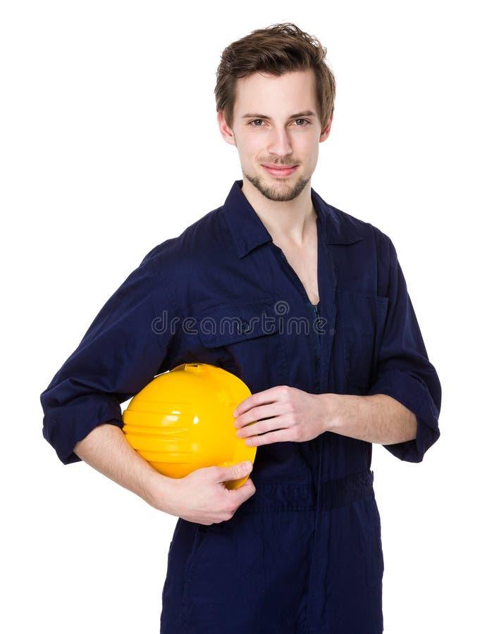 有黄色安全帽的白种人工程师举行 免版税库存图片
