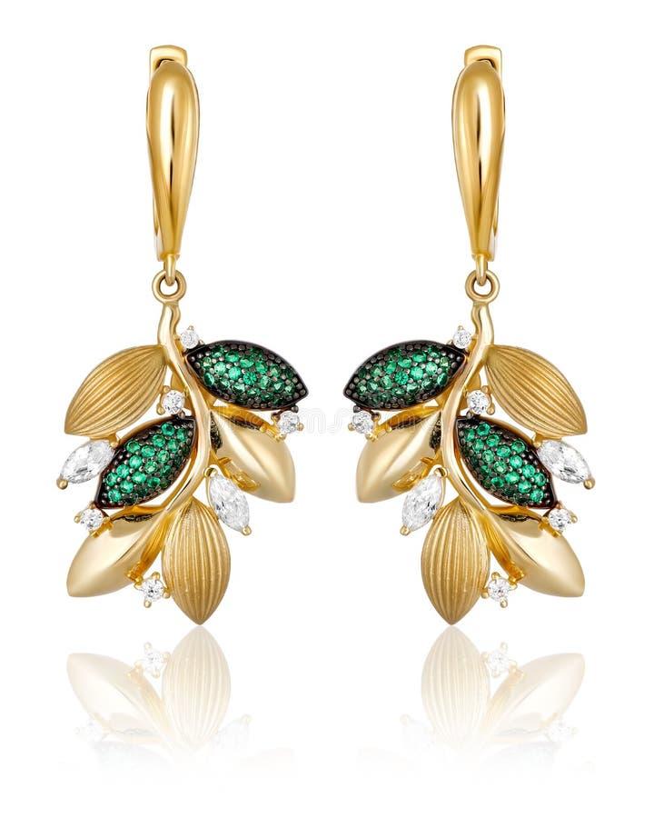 有绿色宝石的金耳环 库存照片