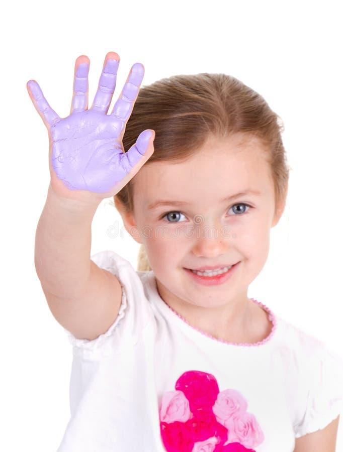 有紫色油漆的一个孩子在她的手 库存照片