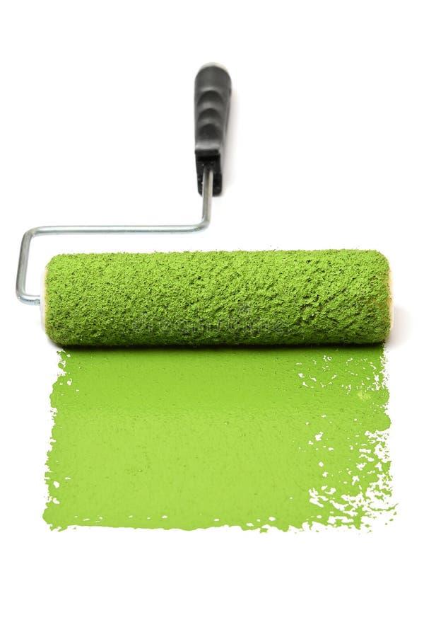 有绿色的漆滚筒 免版税库存照片