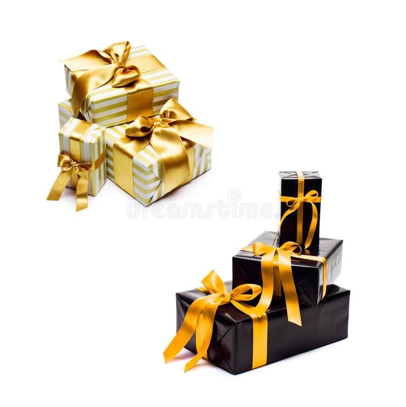 有黄色缎丝带和弓的礼物盒 免版税库存照片
