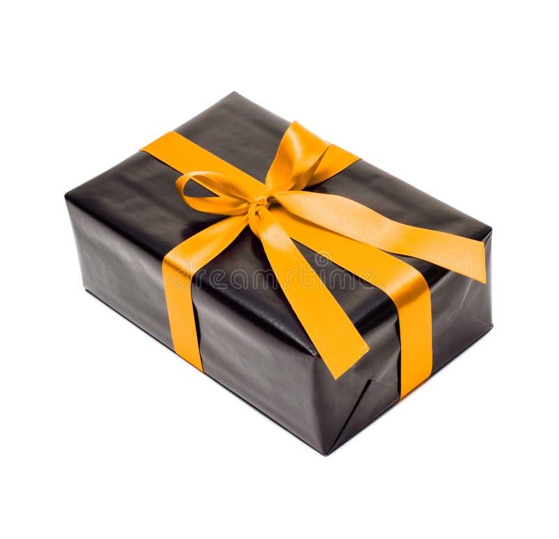 有黄色缎丝带的黑礼物盒 库存照片