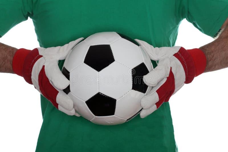 有绿色衬衣的足球运动员 免版税库存图片