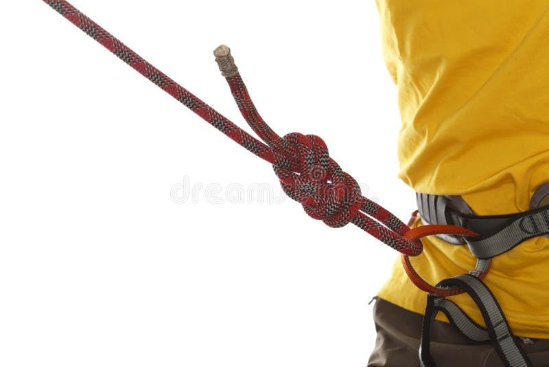 有黄色衬衣的登山人 库存照片