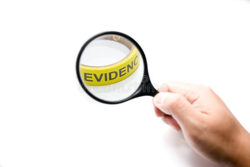 有黄色证据的放大镜在焦点概念 免版税图库摄影