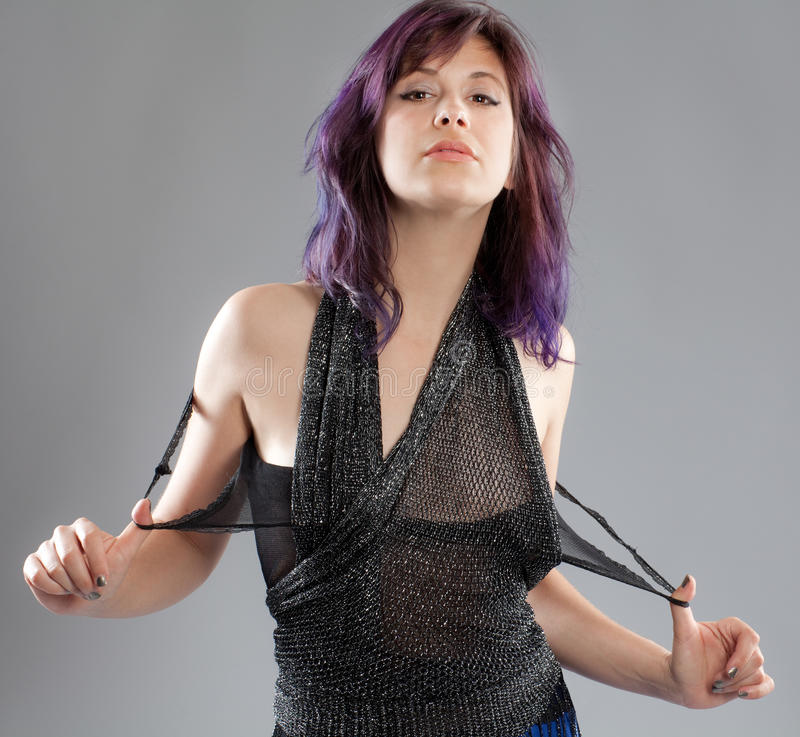 有紫色头发和闪耀的上面的妇女 库存照片