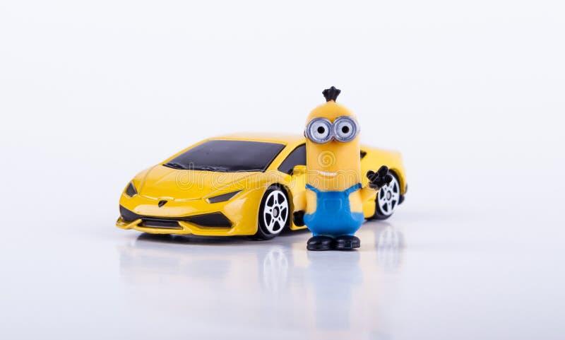 有黄色Lamborghini的奴才 图库摄影