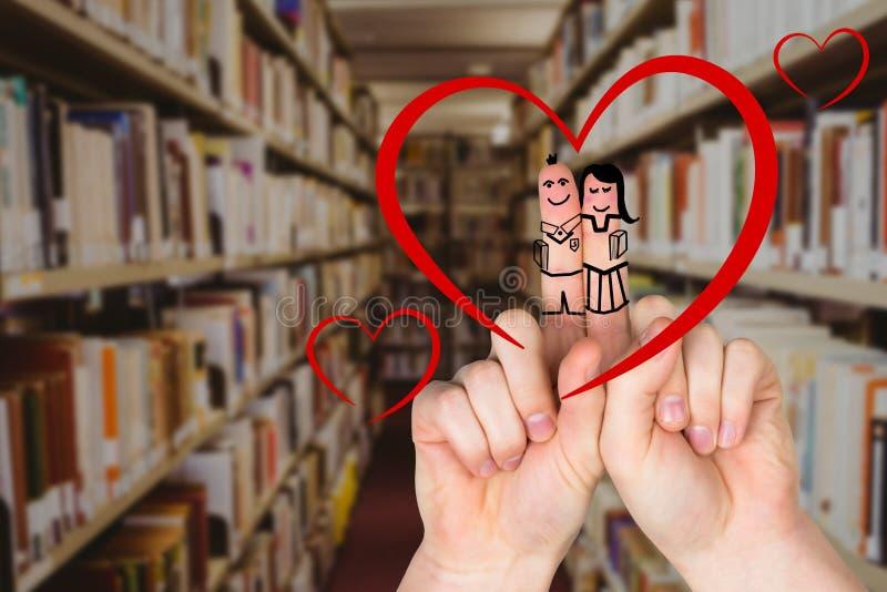 有兴高采烈的面孔的手指在图书馆里 免版税库存照片