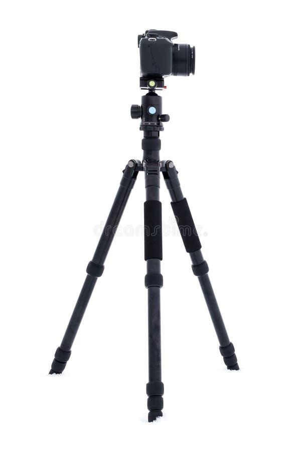 有DSLR照相机的照相机三脚架 免版税库存照片