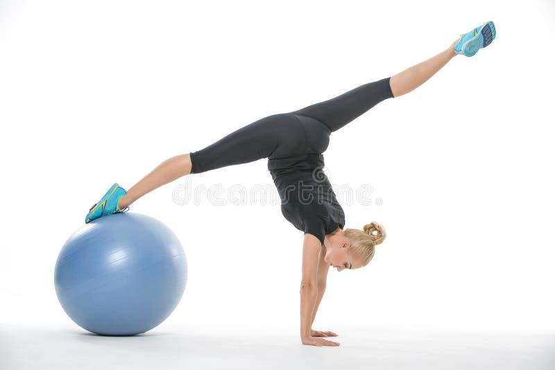 有fitball的体操运动员女孩 免版税库存图片