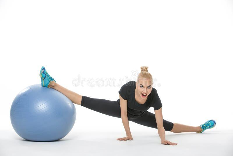 有fitball的体操运动员女孩 免版税图库摄影