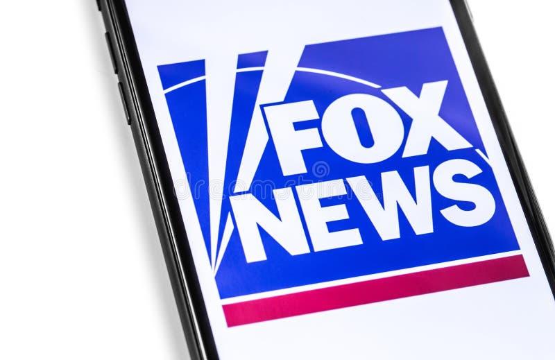 有FoxNews商标的特写镜头智能手机在屏幕上 免版税库存图片