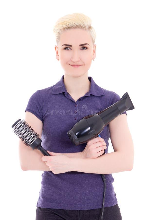 有hairdryer和梳子isola的年轻美丽的妇女美发师 免版税库存图片
