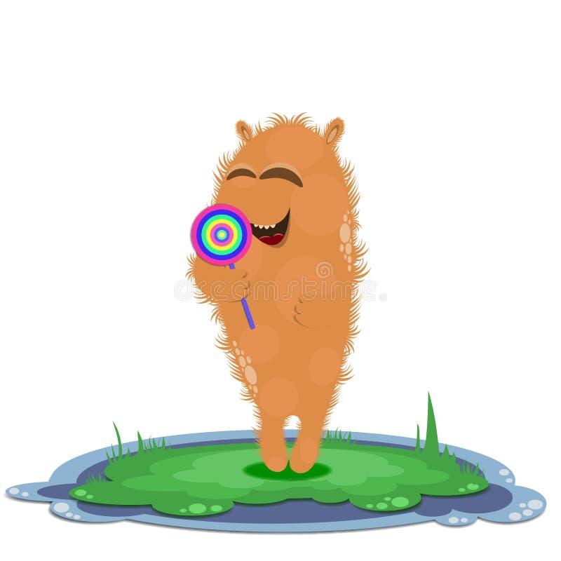 有lollypop的愉快的滑稽的橙色妖怪在草 库存照片