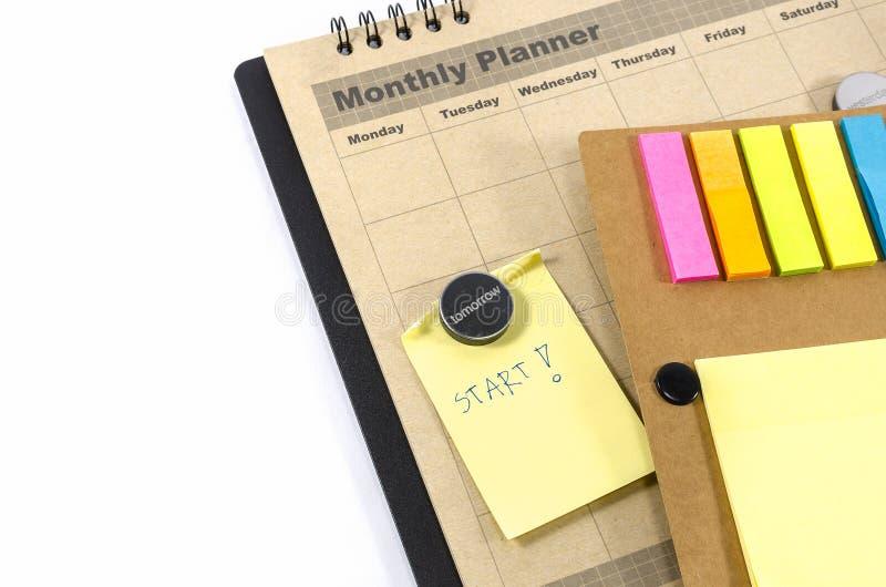 有notedbook的布朗月度计划者 免版税库存照片