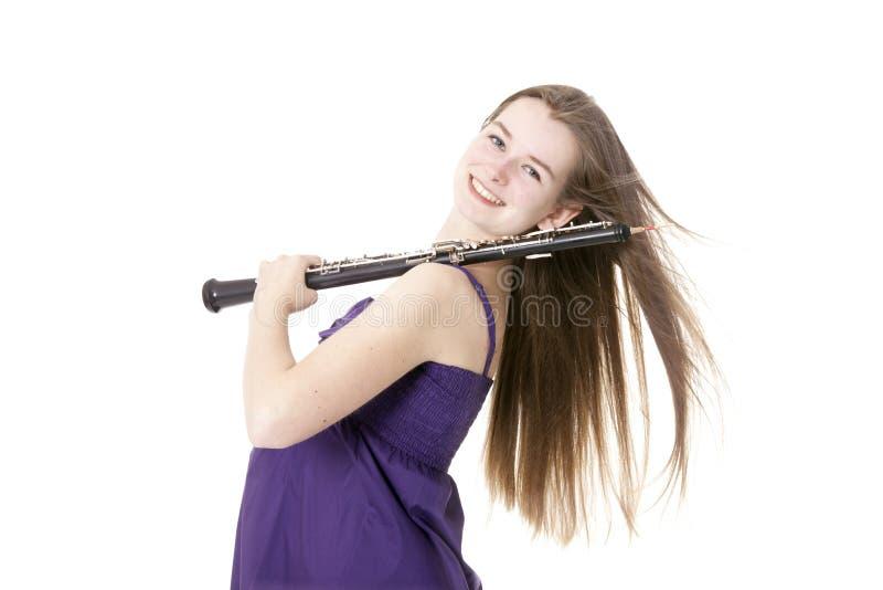 有oboe的女孩反对白色背景 图库摄影