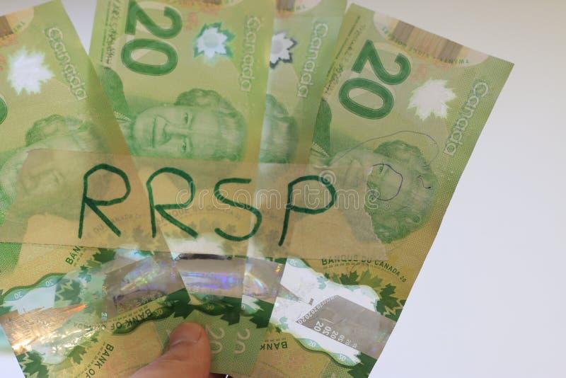 有RRSP标志的笔记本在桌上 E 免版税库存照片