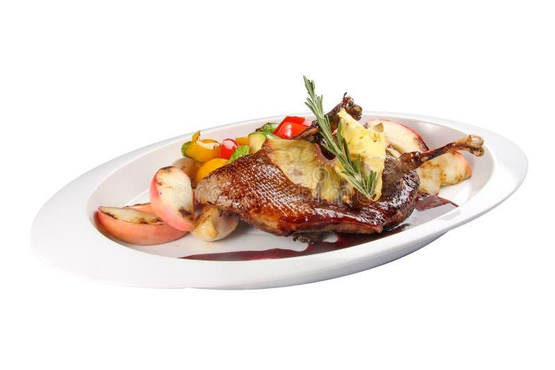 有safflowers和烤菜的鸭子腿 免版税图库摄影