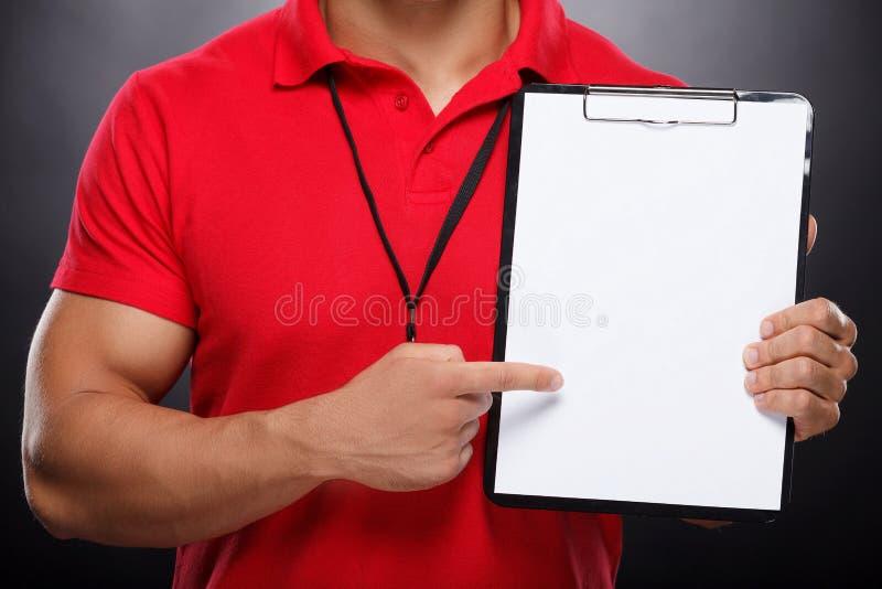 有Whiteboard的教练。 库存图片