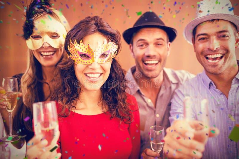 朋友画象的综合图象拿着香槟玻璃的,当笑时 库存照片