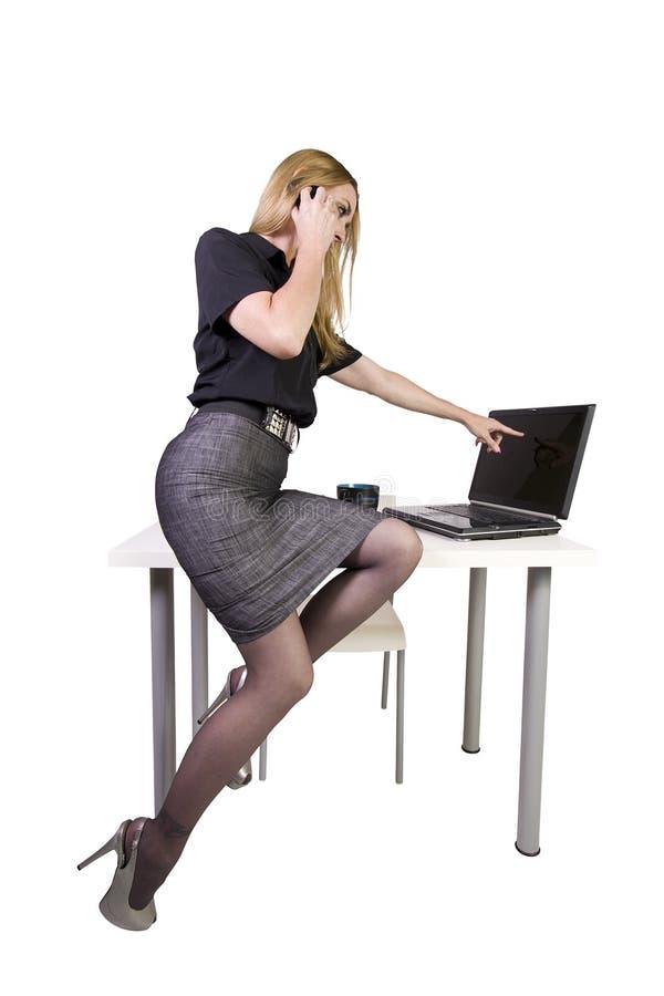 服务台性感的坐的妇女 图库摄影