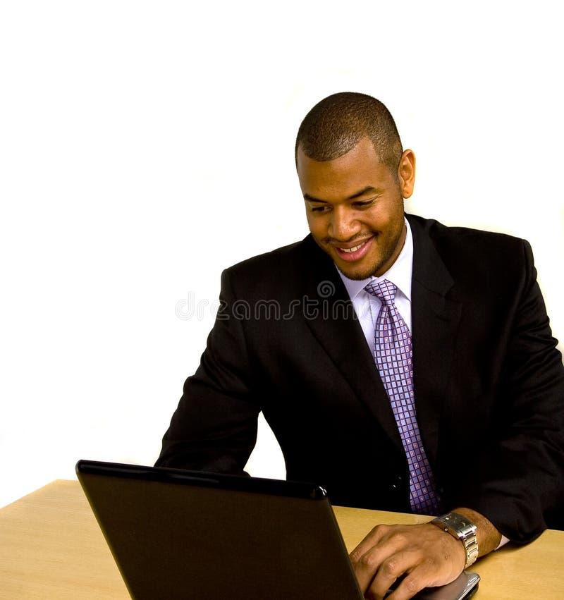 服务台膝上型计算机人工作 库存图片