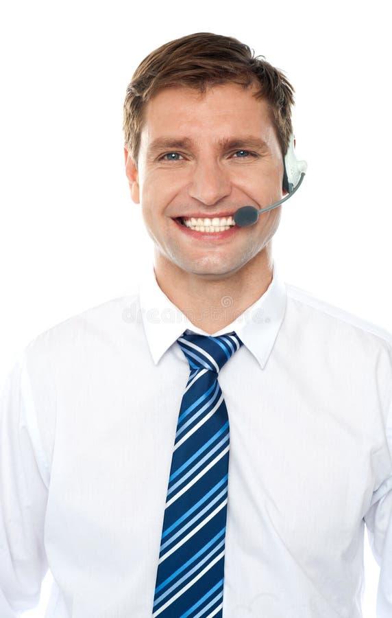 服务台行政英俊的帮助男 免版税库存图片